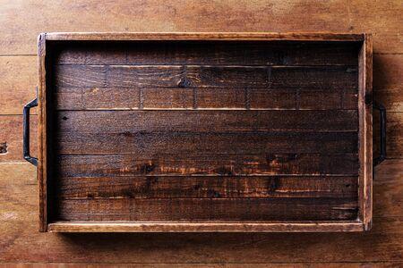 Empty wood tray on wood table Banco de Imagens