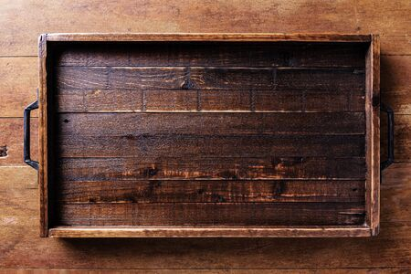 Empty wood tray on wood table Standard-Bild