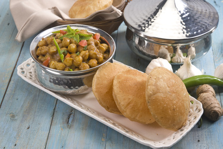 Chana Masala with Puri or Spicy Chickpeas with Puri, Indian Food photo