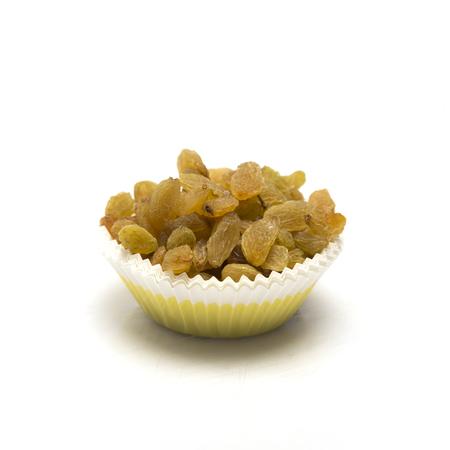 Dried raisins in bowl on white background.