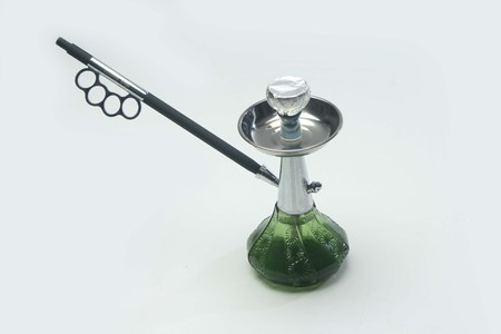 Green transparent hookah with water pipe  isolated on white background.