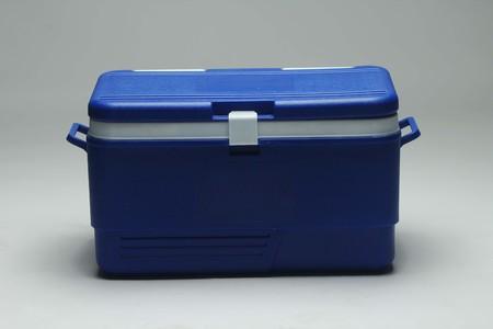 Handheld blue refrigerator, ice box. Isolated on white background.