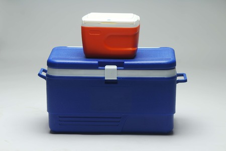 Handheld blue refrigerator,small red ice refrigerator. Isolated on white background. Stock Photo