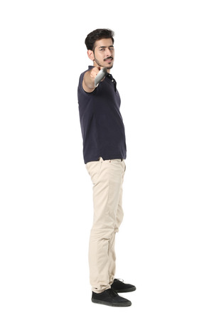 Handsome boy standing with golf stick in hand. Isolated on white background.