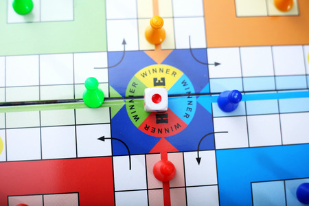 Top view of family ludo board game. Stock Photo