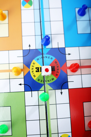 Top view of ludo board game. Stock Photo