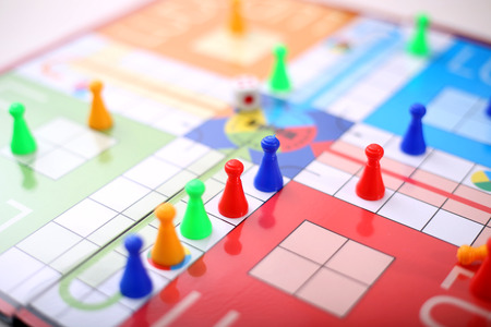 Ludo game with colorful ludo tokens and dice.