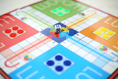 Picture of ludo board family game on the table.
