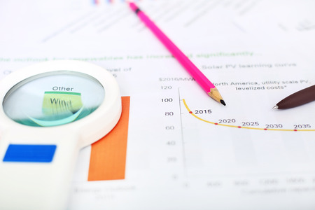 portrait of pen, pencil and magnifying glass on the financial paper. Imagens