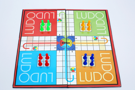 Picture of colorful tokens and dice on the ludo.