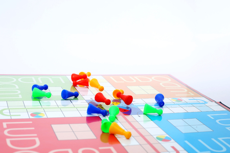 Different colors ludo tokens on the ludo game.