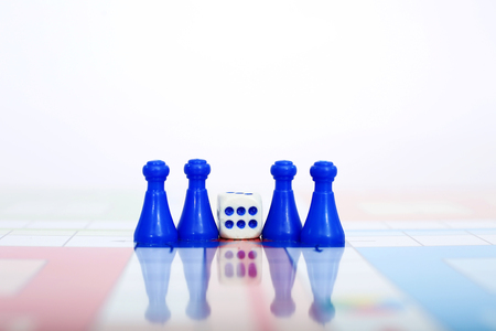 Picture of blue tokens with dice. Stock Photo