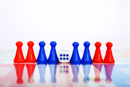 Portrait of red and blue pawns with dice.