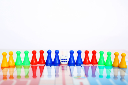 Picture of colorful tokens with dice.