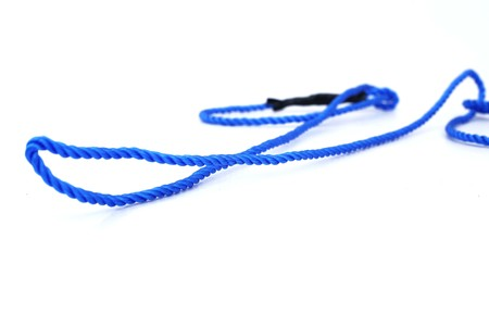 Photo of rope with knot. Isolated on the white background.