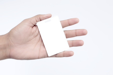 Man is showing tag card in hand. Isolated on the white background.