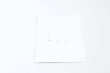 Picture of tag card on the magazine cover. Isolated on the white background.