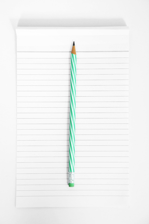 Picture of blank notepad with pencil. Isolated on the white background.