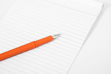 Photo of notebook with pen. Isolated on the white background. 免版税图像