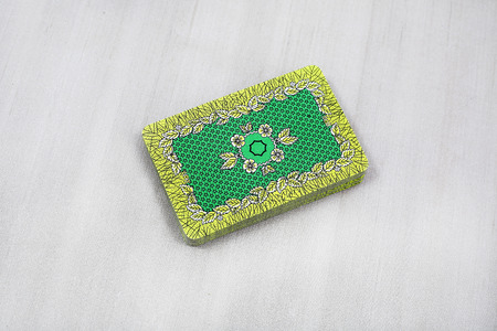 Stack of back green texture playing card. Isolated on the grey background. 免版税图像