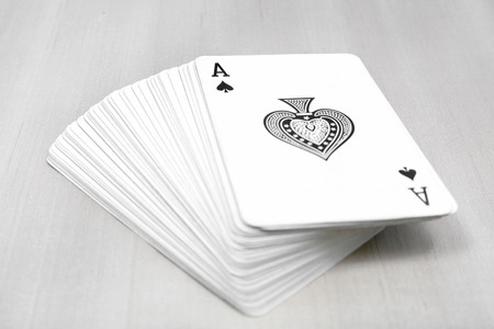 Stack of play card for game. Isolated on the grey background. Stock Photo