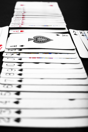 Picture of playing card poker casino. Isolated on the black background. 免版税图像