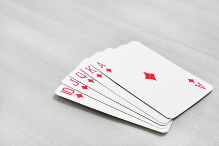 Photo of diamond on playing cards. Isolated on the grey background. Stock Photo