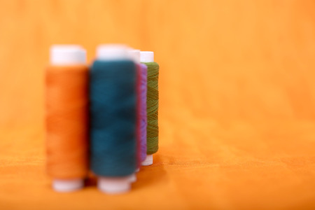 Picture of colorful thread. Isolated on the yellow background.