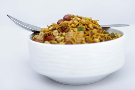 Fried mix namkeen in the bowl. Isolated on the white background.