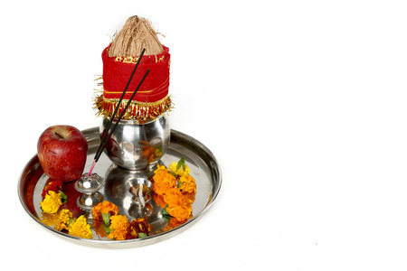 Portrait of kalash with coconut and pooja thali with apple for navratri festival. Isolated on the white background.