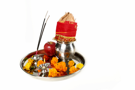 Picture of beautiful Decorated Pooja Thali for festival. Isolated on the white background.