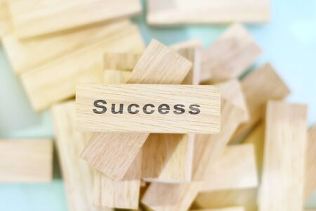 Success word written on wood block. Success text on wooden table for your design, concept.