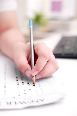 Picture of man filling OMR sheet.