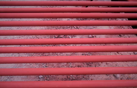Red pipes for fire fighting system and extinguishing water lines in industrial building.
