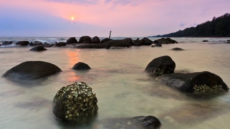 The rock on beach in wide mode. photo