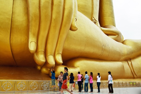The people touch big buddaha so hove happy left. Stock Photo - 9390398