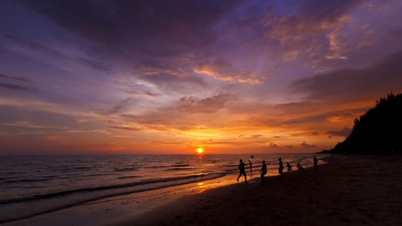Activity on beach sunset time is beautiful photo