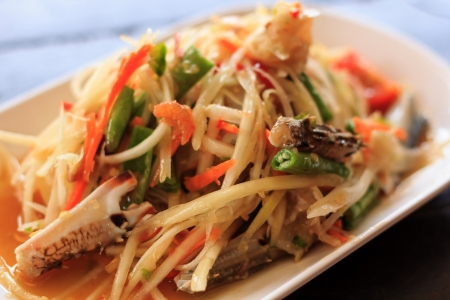 The thai salad from papaya is spicy photo