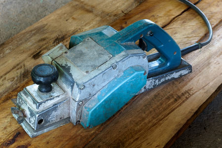 carpenter's sawdust: Plane machine in vintage woodwork with carpenter Stock Photo