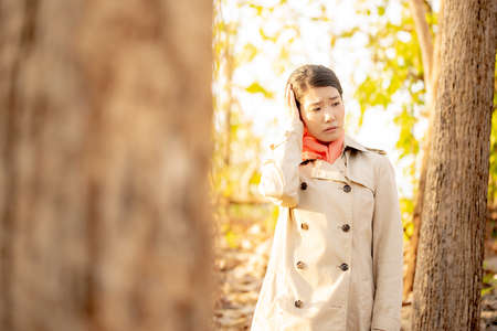 The image of a woman in the nature of autumn