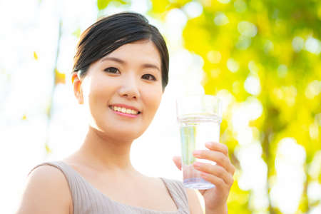 a Japanese woman with a glass of water Stock fotó