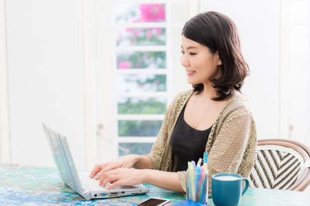 a woman who operates a computer in a bright room