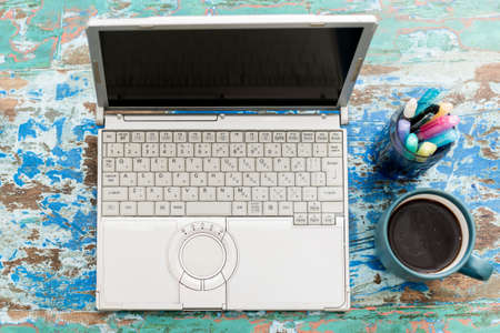 Laptops, stationery and coffee on your desk