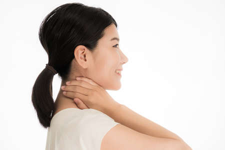 Smiling young Japanese woman with hands around her neck