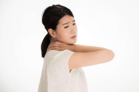 a woman suffering from a medical condition with her hands around her neck