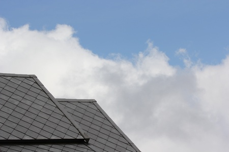 Slate roof against blue sky Archivio Fotografico