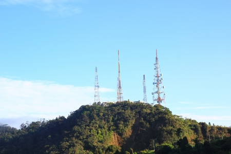 Telecommunications towers on hilltop photo