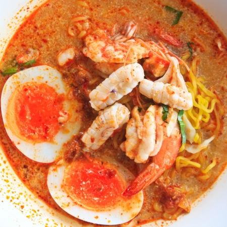 tom: Tom Yam Koong and Squid soup with noodles :Thai cuisine