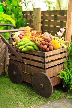 Wooden carriage with fruits photo