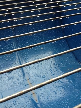 steel: water drop on line steel Stock Photo